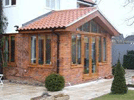 a picture of a rear conservatory with a tiled roof